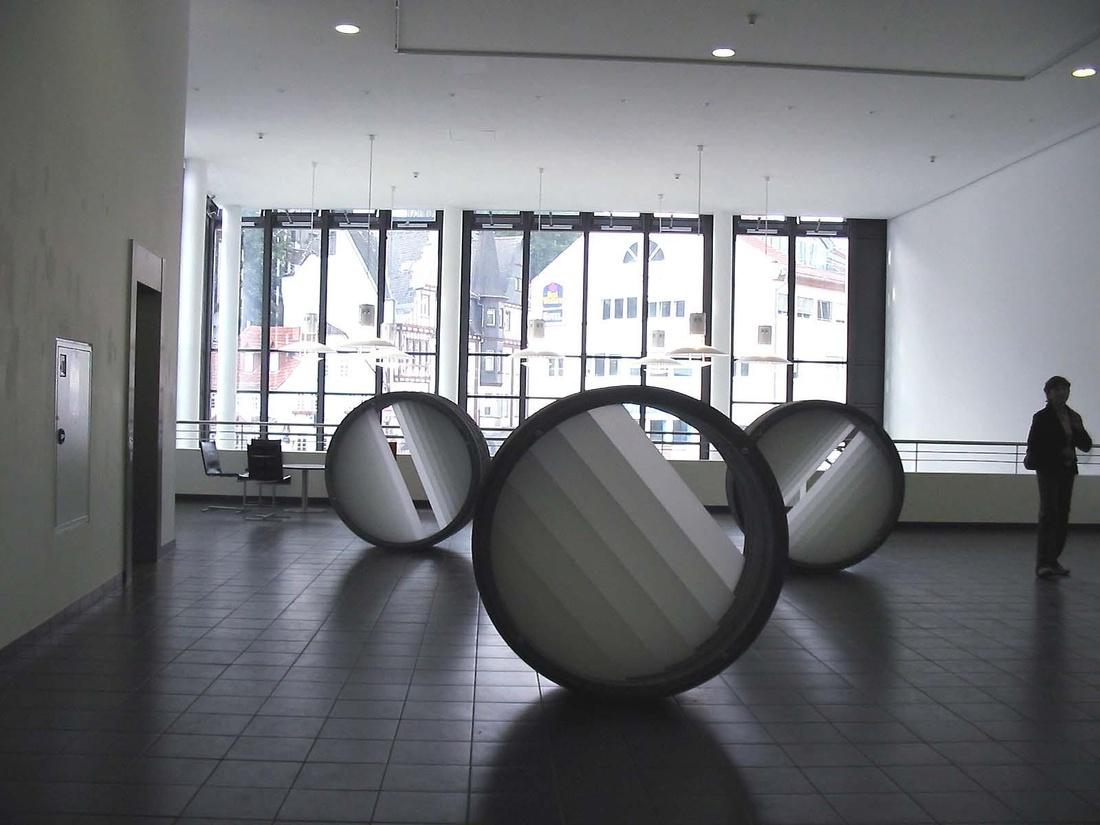 """Annette Sauermann, Lichttrommel (""""Light Drum""""), 2006Cast concrete and light filter, 55 inch diameter x 22.8 inchesCourtesy C. Grimaldis Gallery and the artist."""