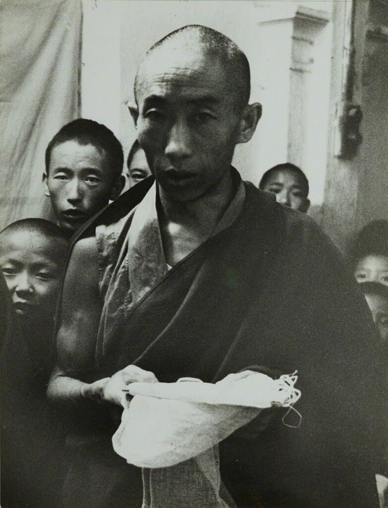 Tibetan religious ceremony offering of the white scarf