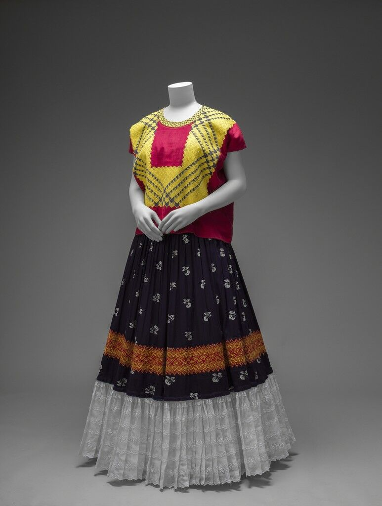 Cotton huipil with machine-embroidered chain stitch; printed cotton skirt with embroidery and holán