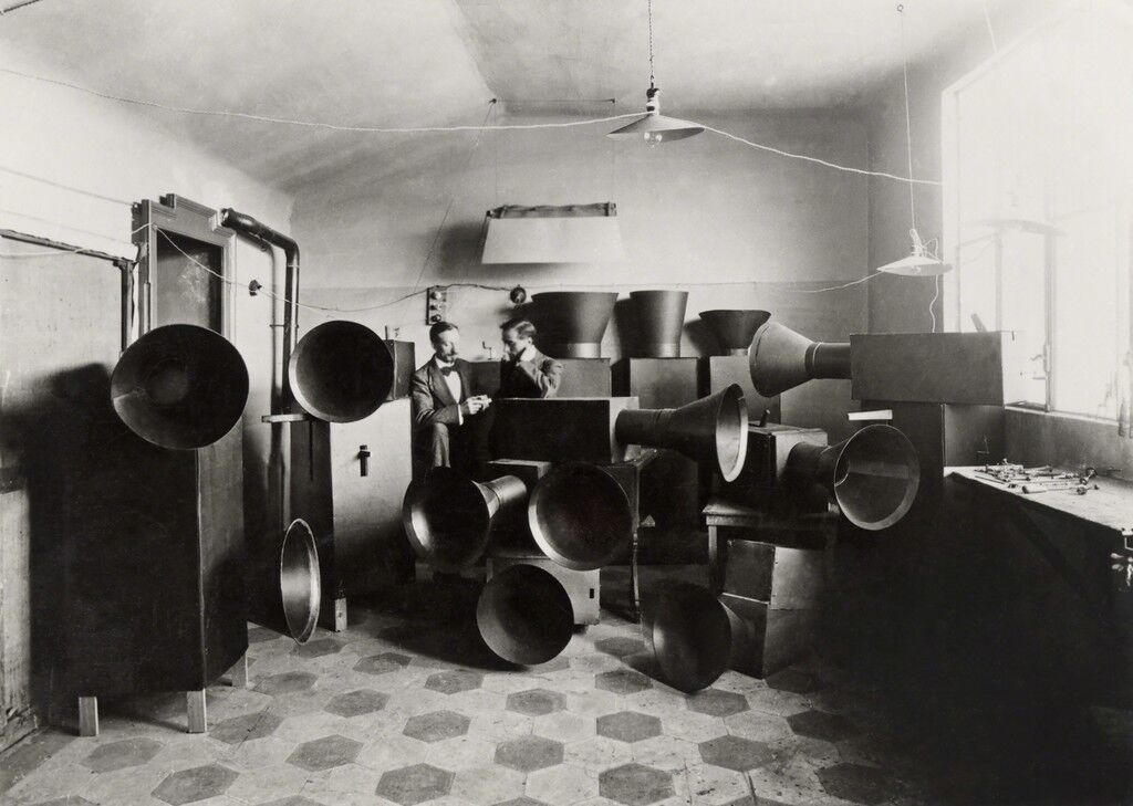 Luigi Russolo and his assistant Ugo Piatti in his studio with the intonarumori (noise machines), Milan