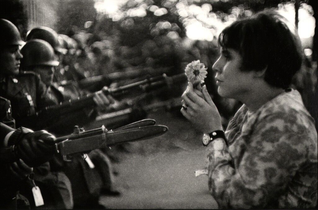 Young girl holding a flower, demonstration against the war in Vietnam, Washington.