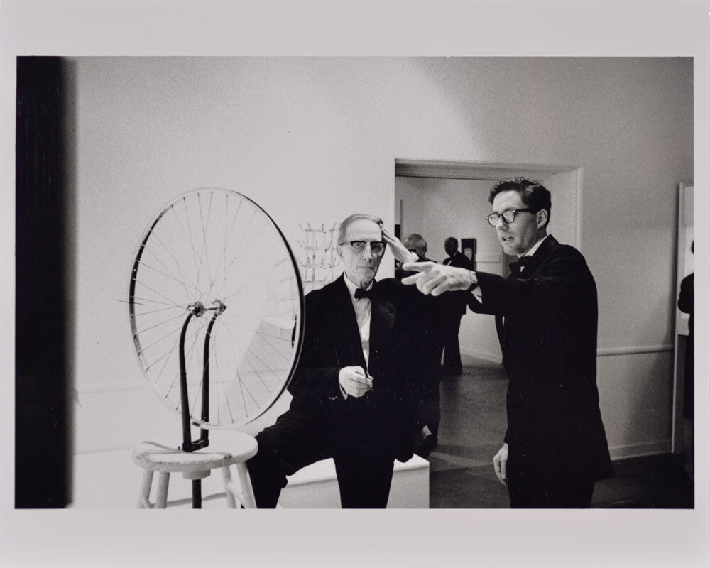 Duchamp with Walter Hopps Pointing, Duchamp Retrospective, Pasadena Art Museum
