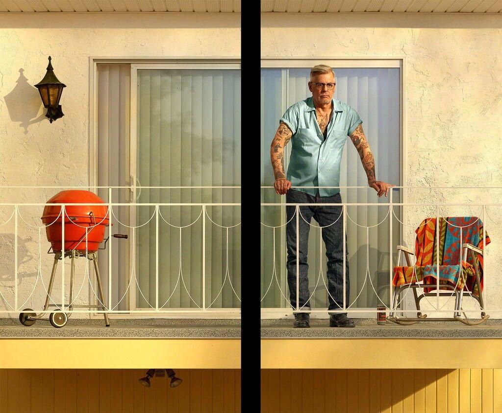 Tattooed Man on Balcony
