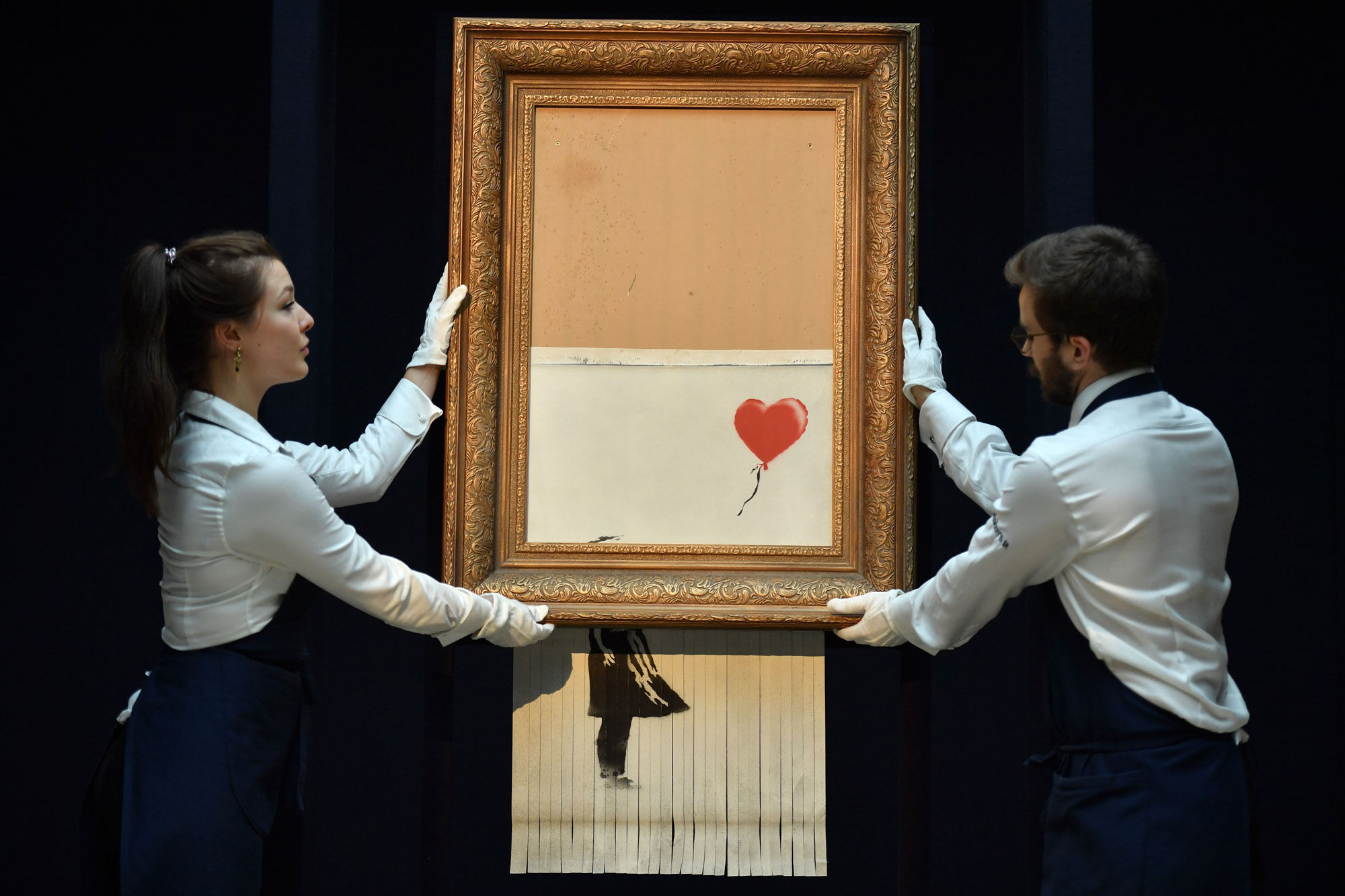 Banksy, Love is in the Bin, 2018. Photo by Ben Stansall/AFP/Getty Images.