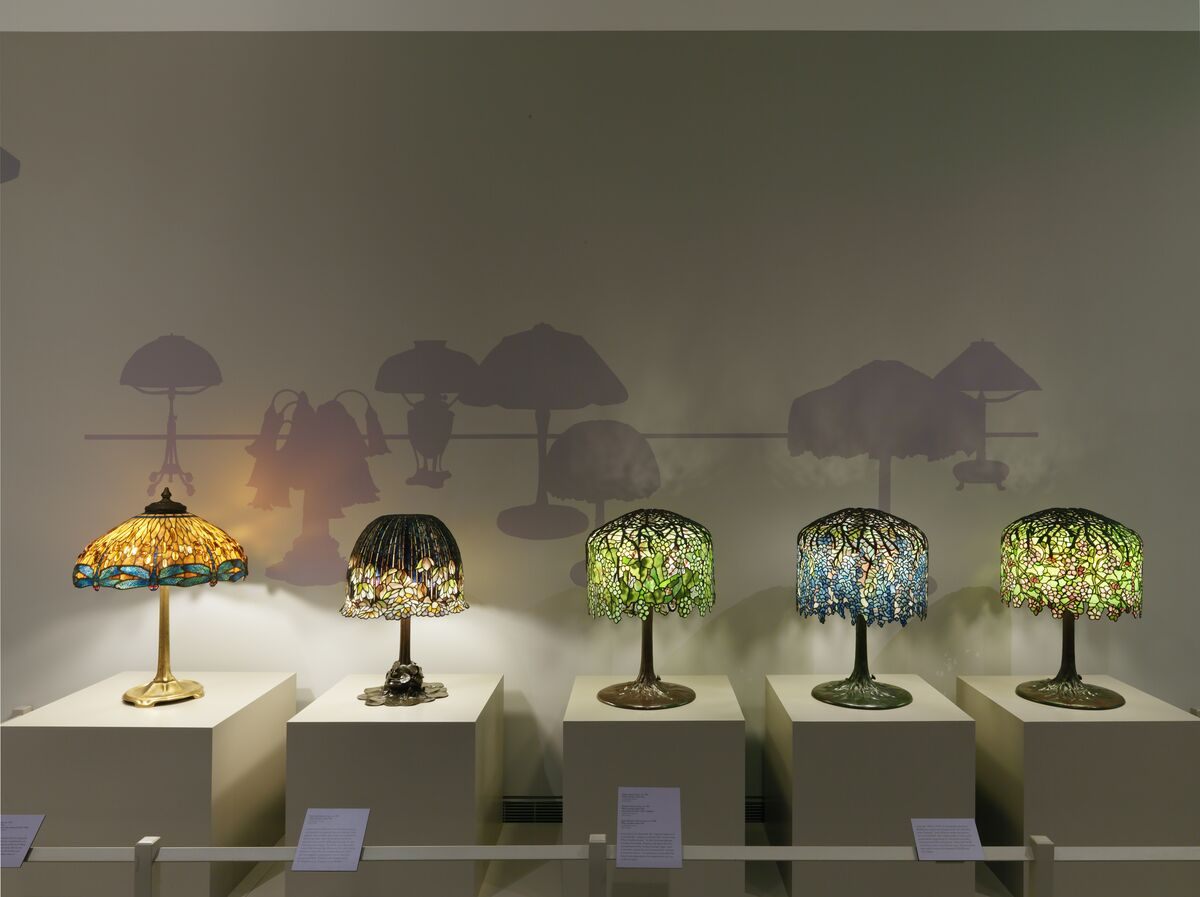 "Installation view of ""A Passion for Tiffany Glass,"" in the The Neustadt Gallery at the Queens Museum."