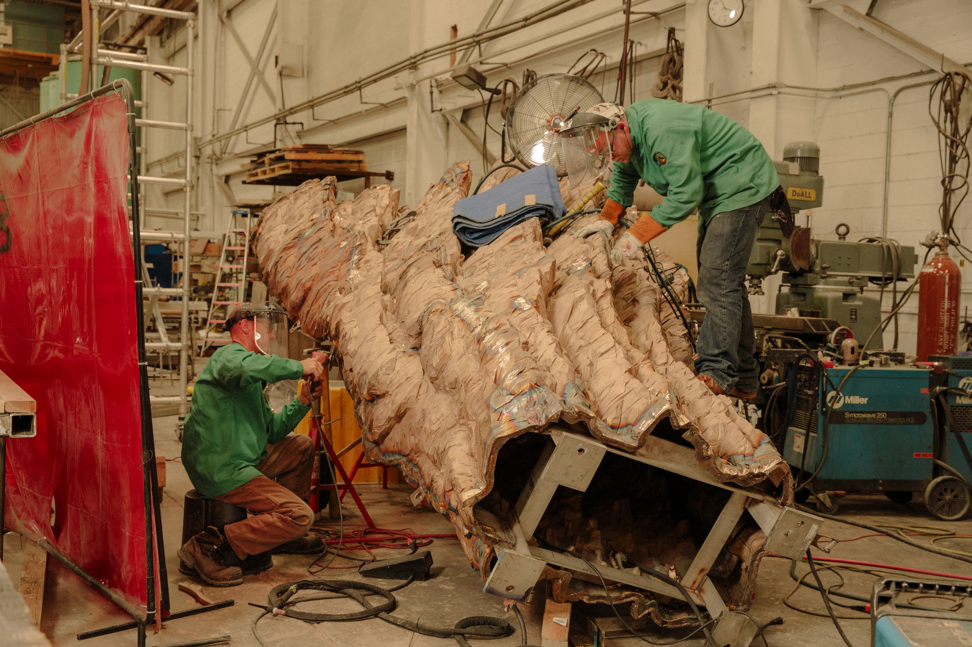 Craftsmen welding and finishing bronze casting for a work by Ursula von Rydingsvard. Photo by Ricky Rhodes for Artsy.