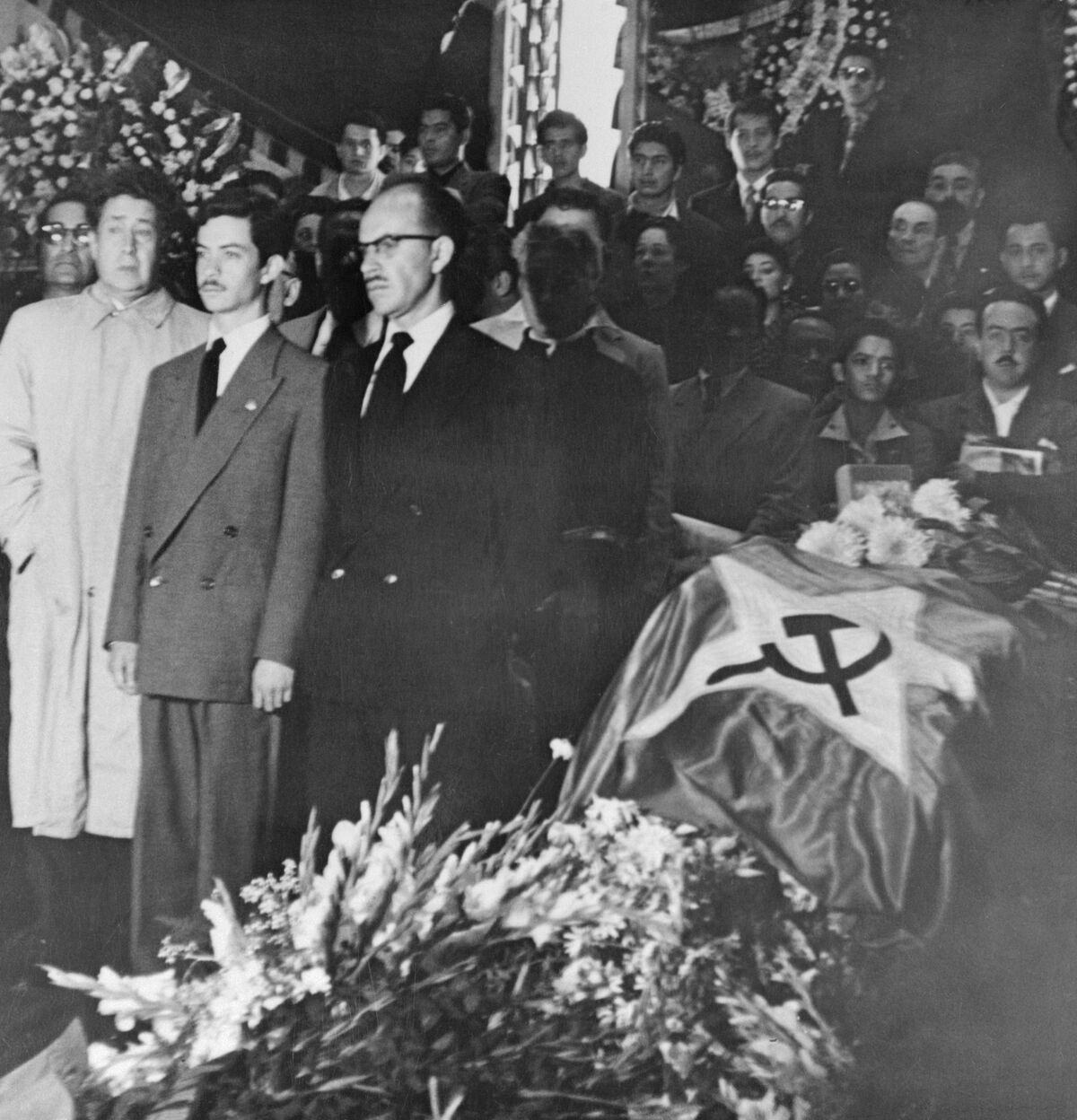 The hammer and sickle emblem is draped over the casket of Frida Kahlo at the Palace of Fine Arts in Mexico City, 1954. Photo by Bettmann via Getty Images.