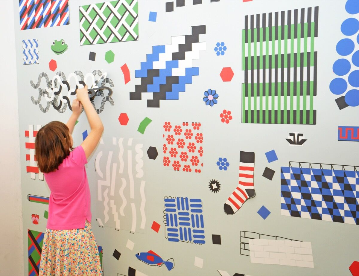 Marilyn Bruno tests out CMA's art wall. Photo by Veronica Bruno, High Value Images. Courtesy of Veronica Bruno.