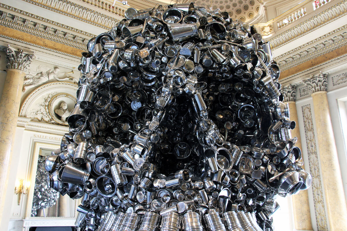 Detail of a work by Subodh Gupta at the Monnaie de Paris in 2018. Photo by Fred Romero, via Flickr.