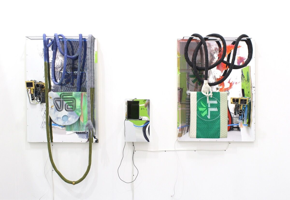 Installation view of Derek Larson, Static Void: All You Need to Attract Click-Throughs, 2016, and Host: You Need to Upload Two Different Versions, 2016, ada gallery's booth at UNTITLED, Miami Beach, 2016. Photo courtesy of the gallery.