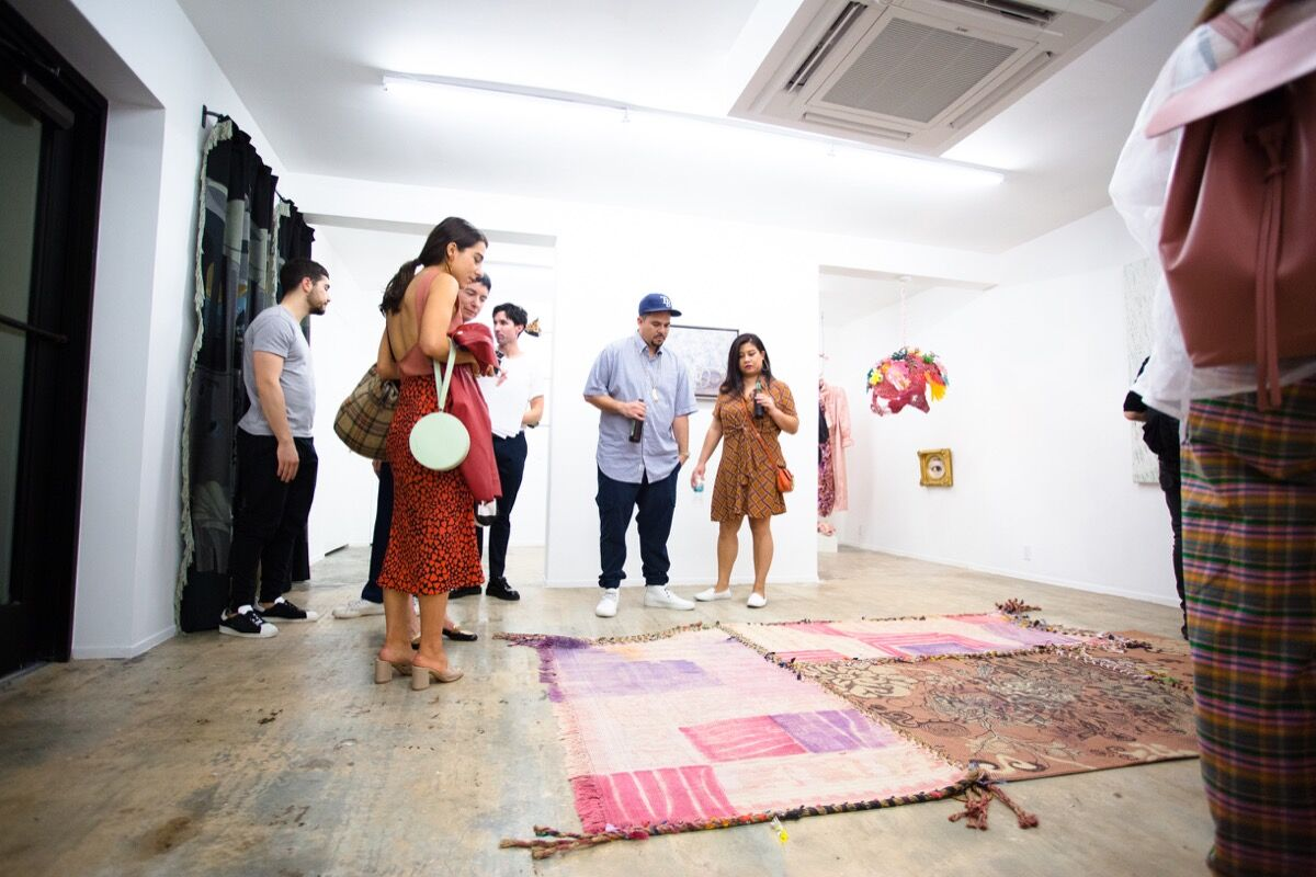 """Guests in the downstairs gallery of Nina Johnson for the opening of """"Of Purism"""" curated by Charlap Hyman and Herrero. Courtesy Nina Johnson."""