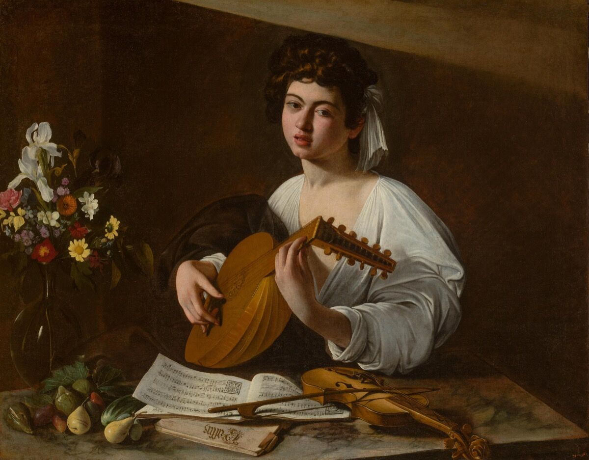 Michelangelo Merisi da Caravaggio. The Lute Player, ca. 1595, in the Hermitage Museum. Image via Wikimedia Commons.