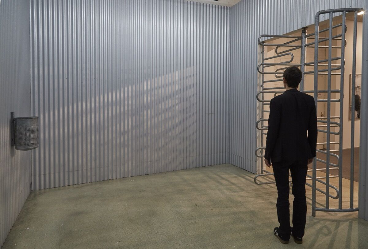 Installation view of Olaf Metzel, Sammelstelle, 1992, at Wentrup's booth at Art Basel, 2016. Photo by Benjamin Westoby for Artsy.