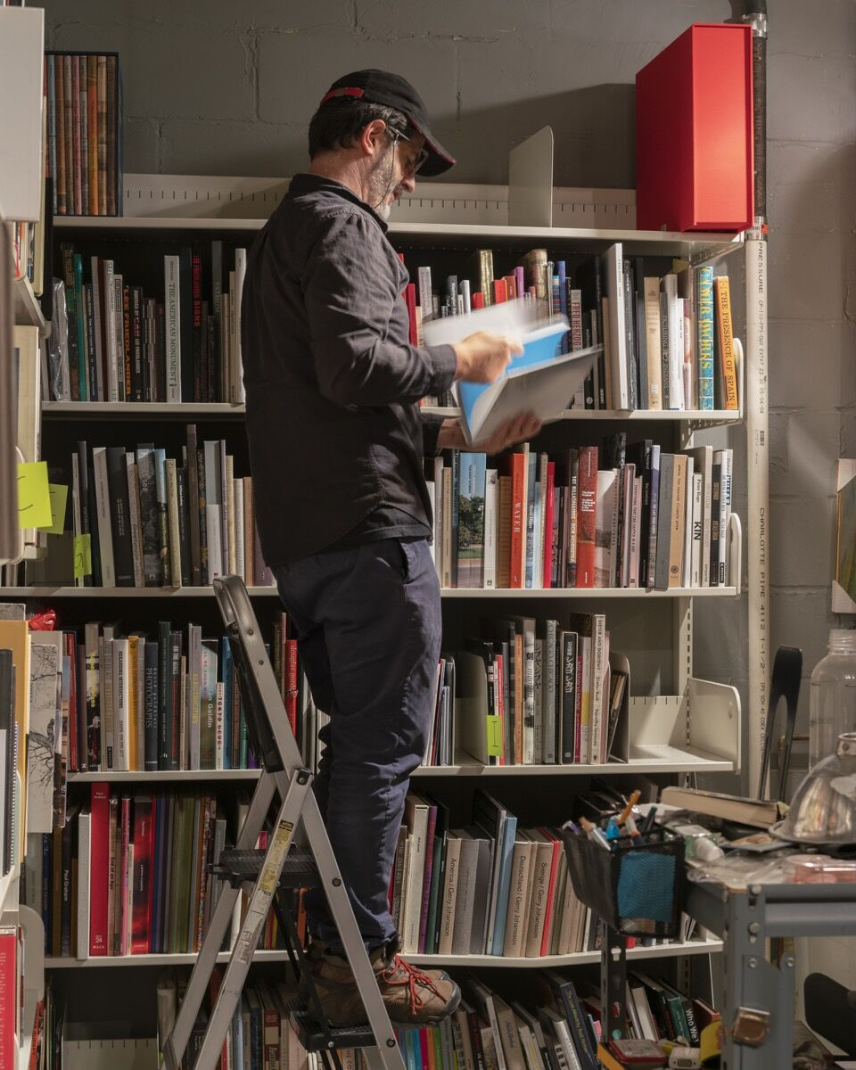 Alec Soth in his photo book library. Photo by Ethan Jones.