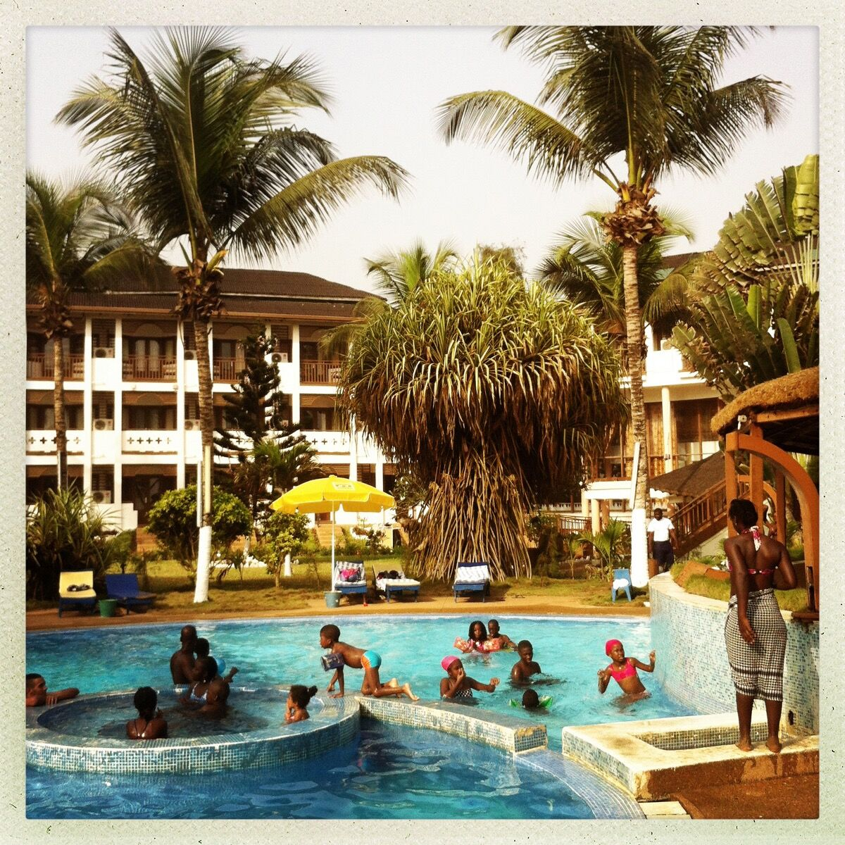 Poolside scene at a hotel in Grand-Bassam, a popular beach community outside of Abidjan, Ivory Coast. Photo by @pdicampo.