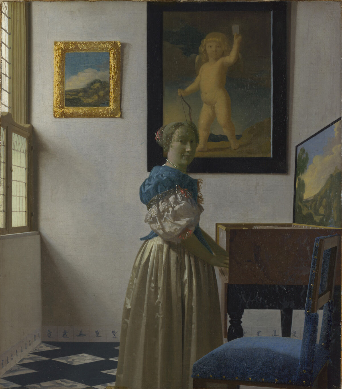 Vermeer, uma senhora em pé em um virginal, 1670-1672. Galeria Nacional, Londres. Via Wikimedia Commons.