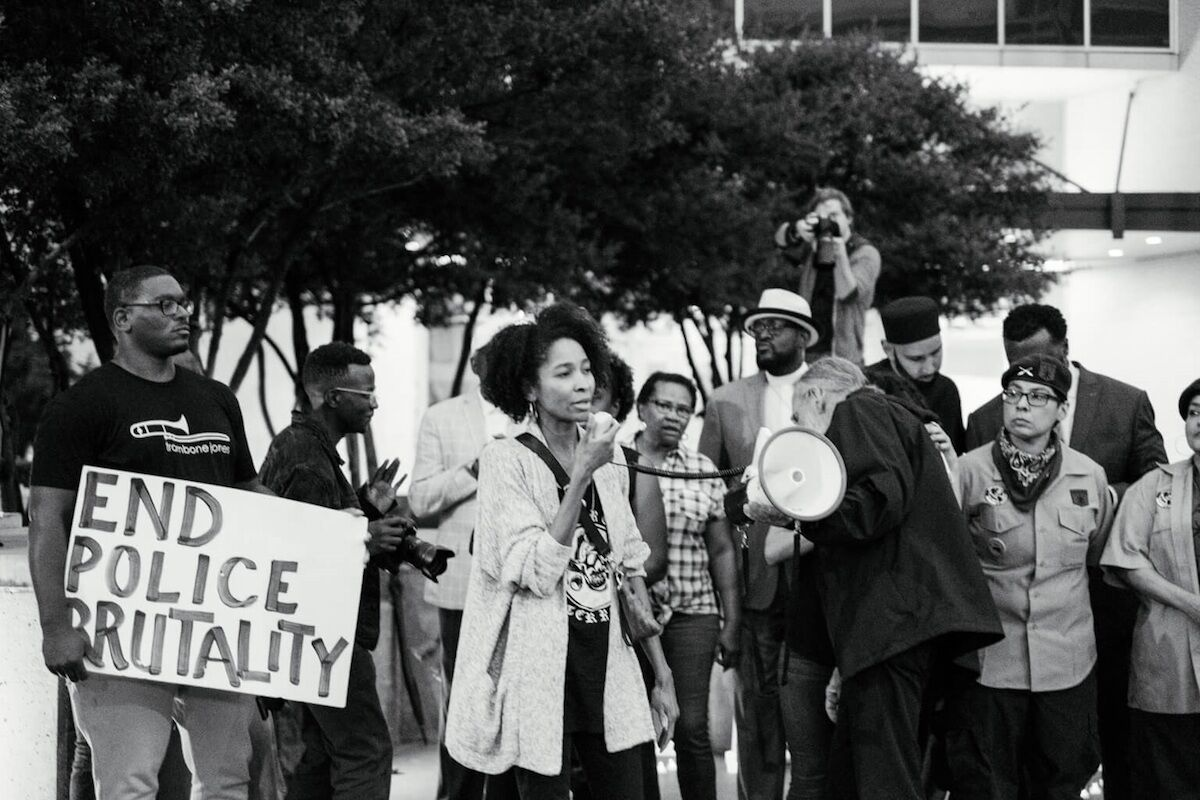Artist lauren woods at a rally for Botham Shem Jean. Photo courtesy the artist.