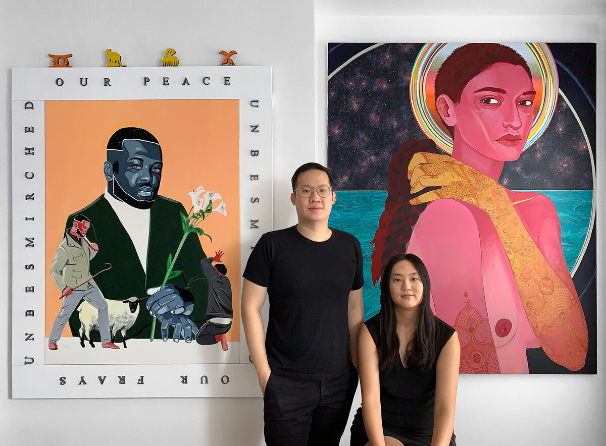Portrait, from left to right, of Steven Abraham and Lisa Young with, from left to right, Conrad Egyir, Agape. Allegory of Love, 2019; and Nadia Waheed, Moksha, 2019. Courtesy of the artists and Young-Abraham Collection.