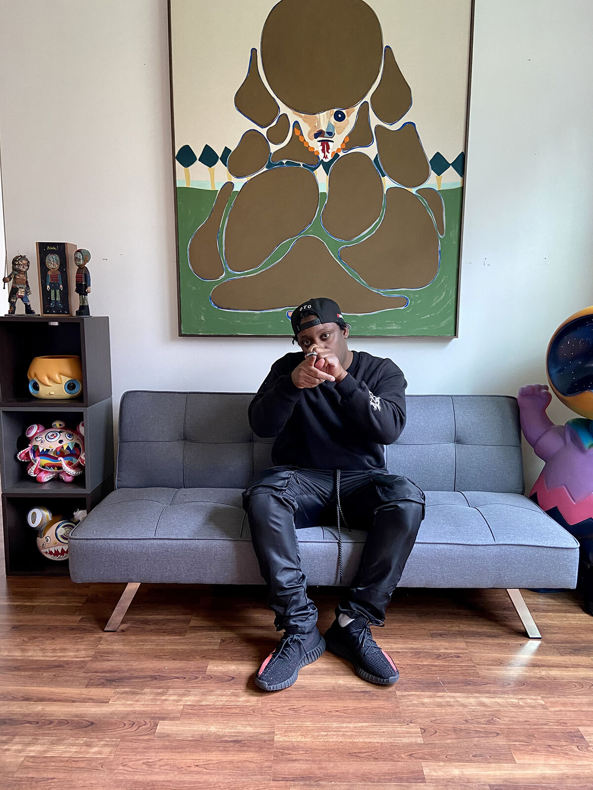Portrait of Demetrius Butler with works, from left to right, by Reen Barrera and Susmu Kamijo, 2021. Courtesy of Demetrius Butler.