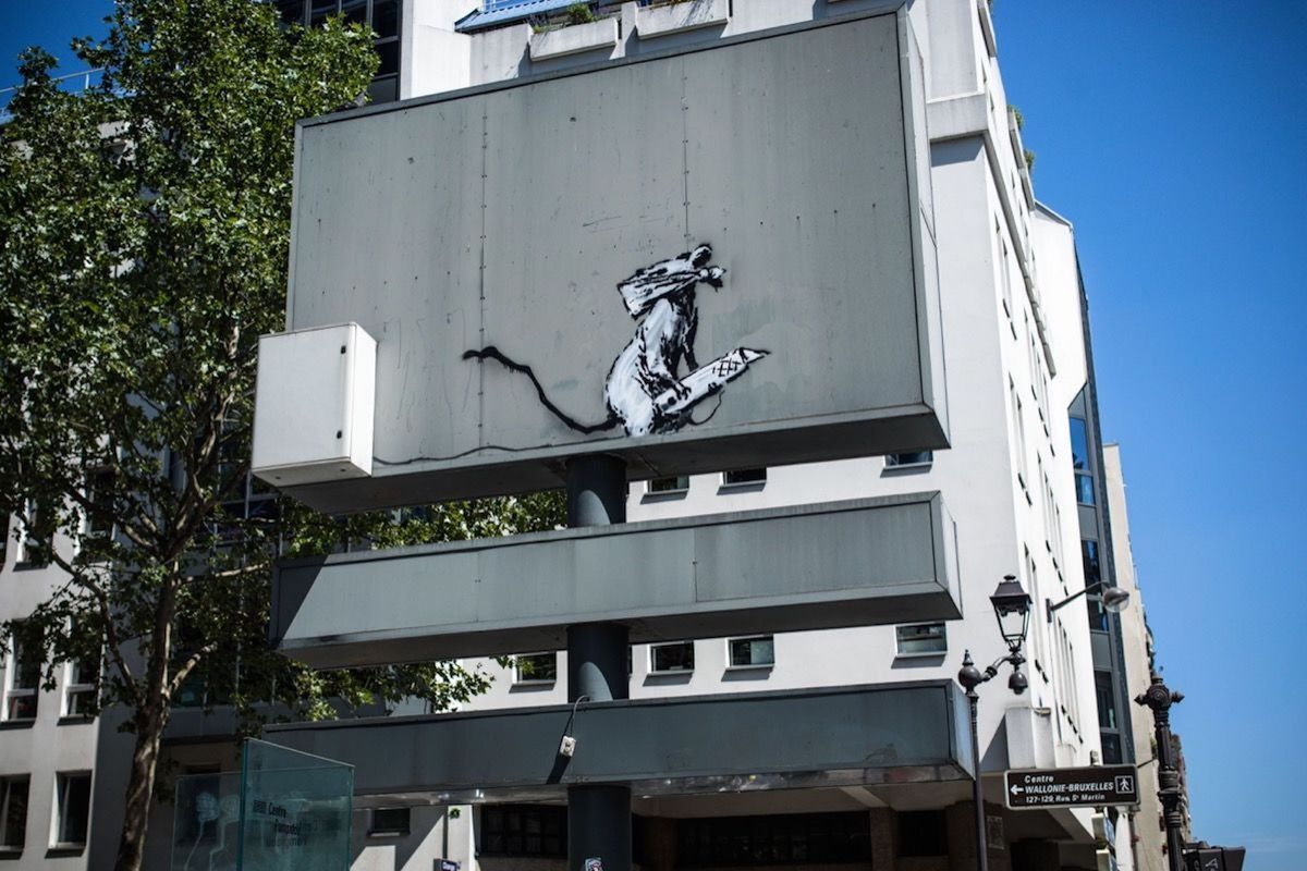 An artwork by Banksy that appeared in June 2018 on a billboard in Paris, and which was subsequently stolen. Photo by Aurelien Morissard / IP3 / Getty Images.