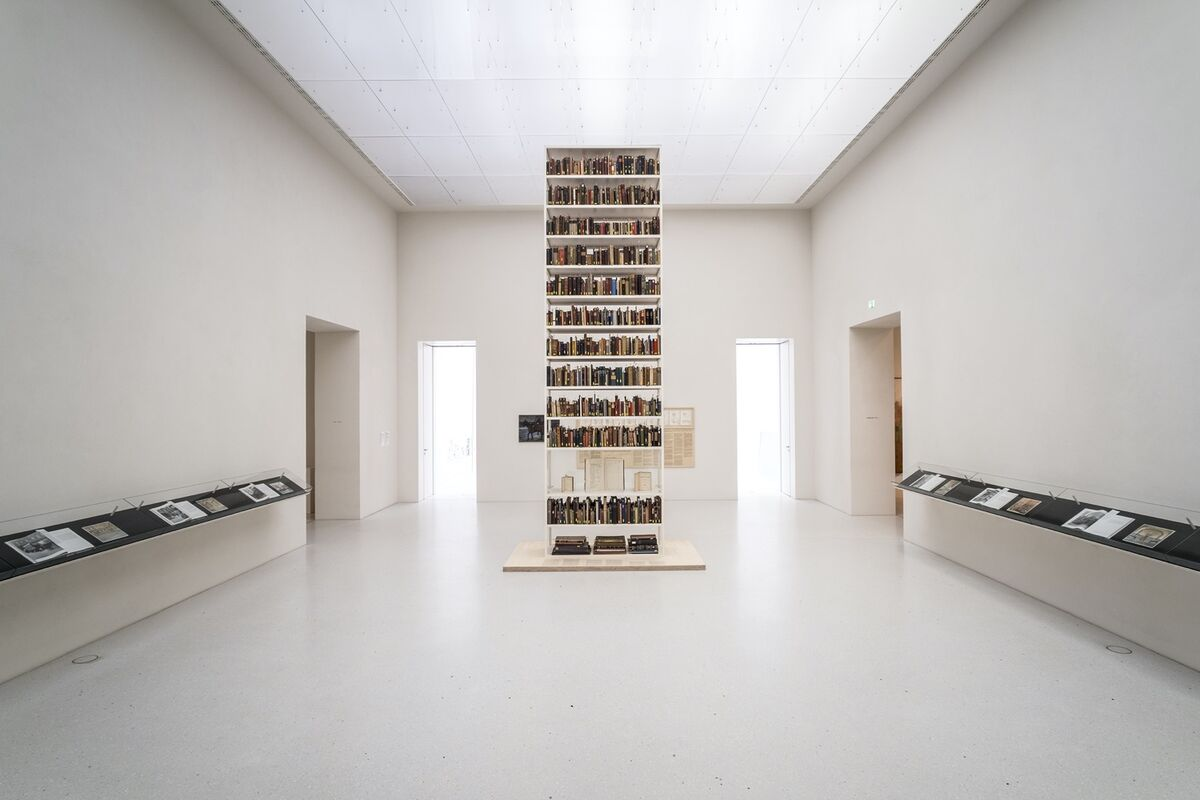 """Maria Eichhorn, detail of Unlawfully acquired books from Jewish ownership, 2017, from """"Rose Valland Institute,"""" at documenta 14, Neue Galerie, Kassel. © VG Bild-Kunst, Bonn 2021. Photo by Mathias Völzke. Courtesy of the artist."""