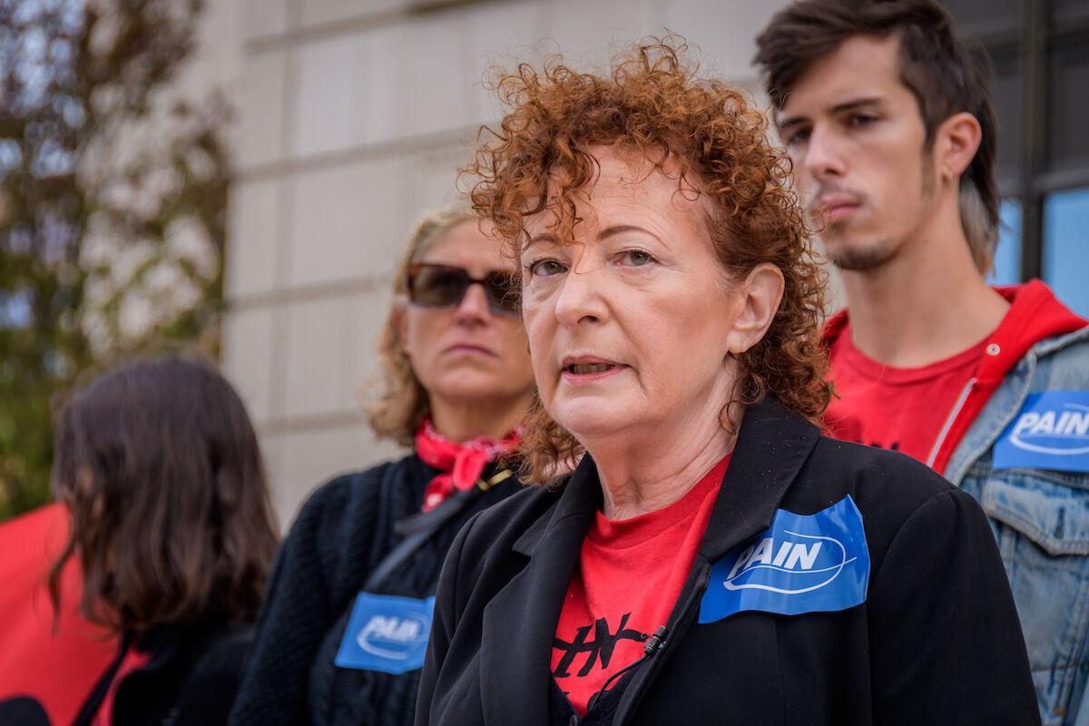Nan Goldin leading an earlier PAIN protest. Photo by Erik McGregor/LightRocket via Getty Images.