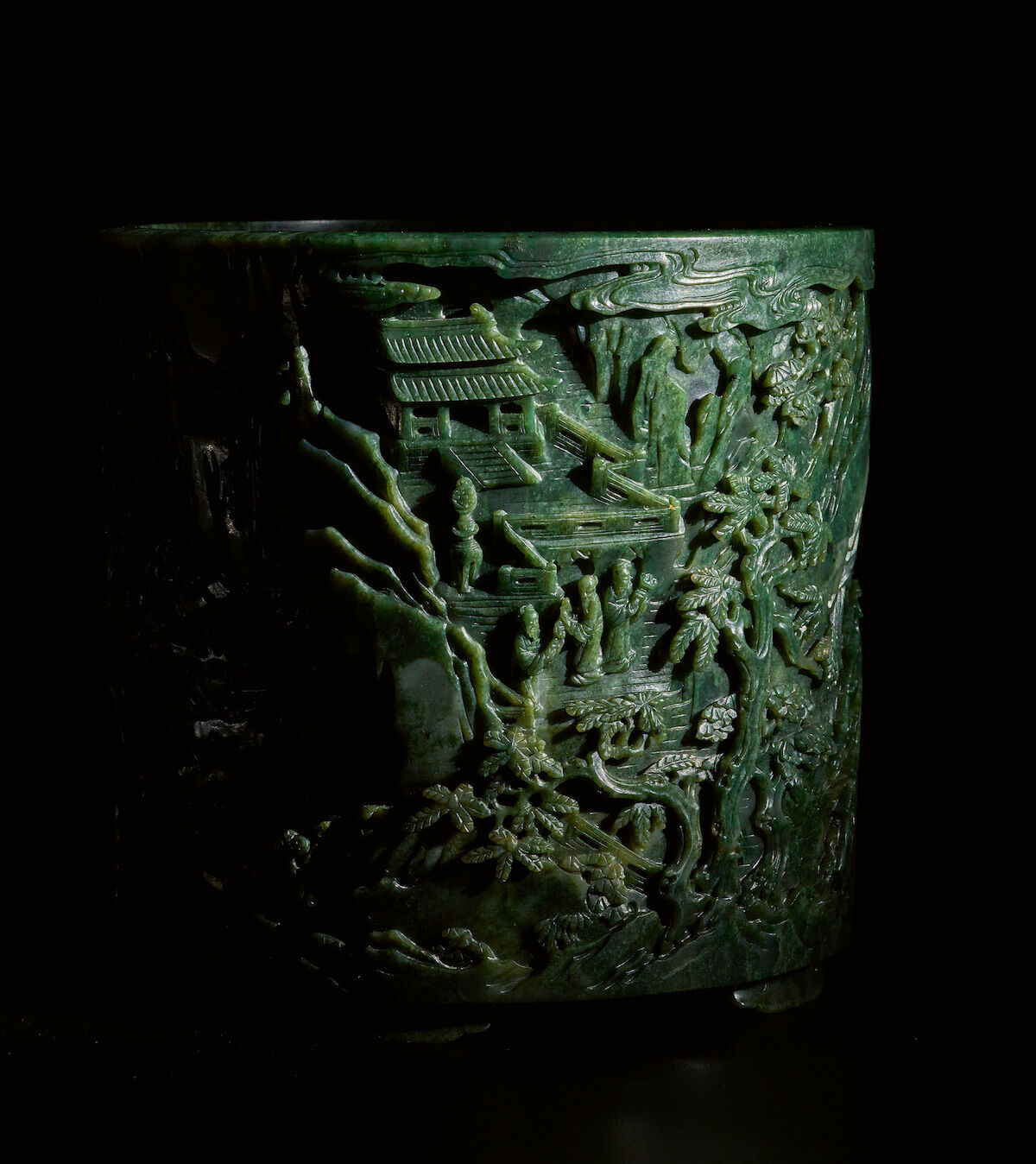 """A finely carved large spinach-green jade """"Immortals"""" brushpot, Qing Dynasty, Qianlong Period. Est. $500,000–700,000. Courtesy Sotheby's."""