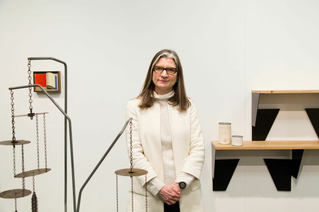 Mary Ceruti with works by Martin Boyce, Martin Creed, and Roman Ondak at Johnen Galerie's Booth. Photo by Christophe Tedjasukmana for Artsy.