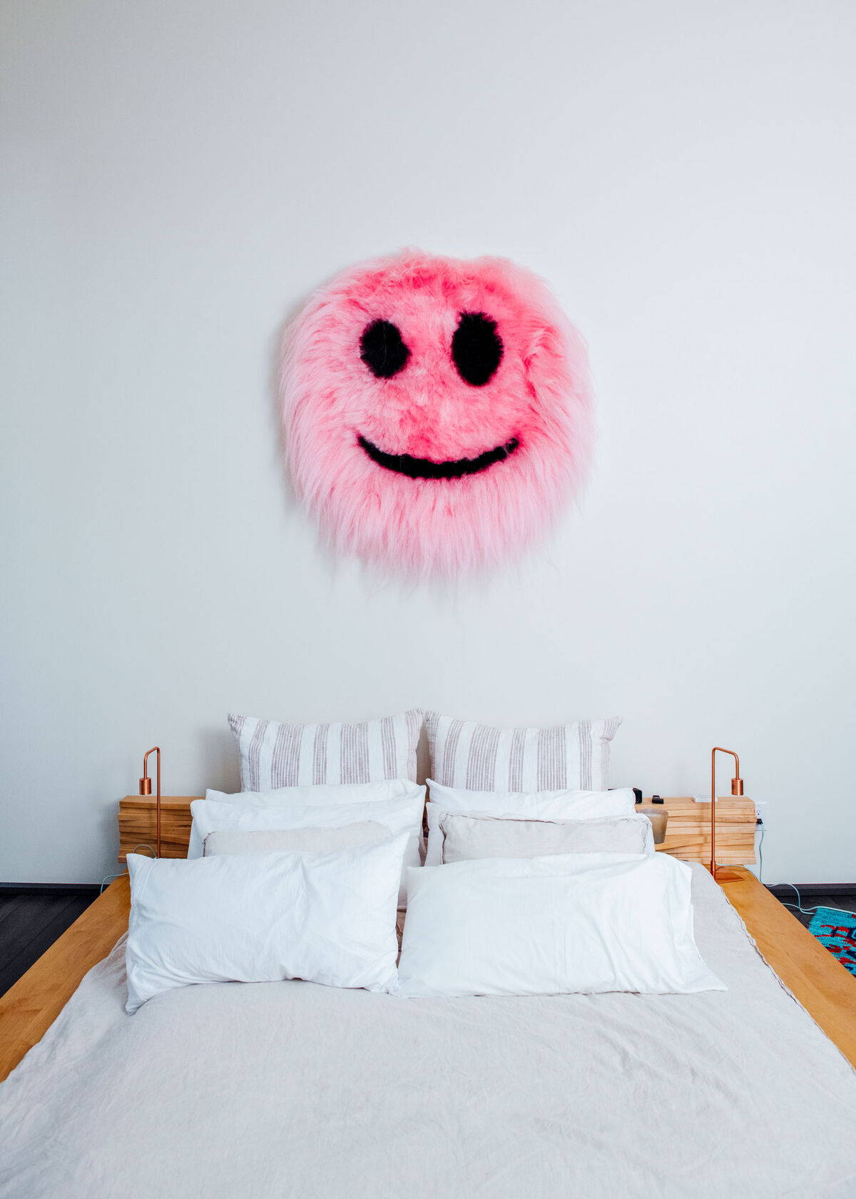"""This is one of my favorites; it just pops this room off,"" Aoki says of this smiley by Icelandic artist Shoplifter, whose work incorporates real and synthetic hair. Photo by Brian Guido for Artsy."