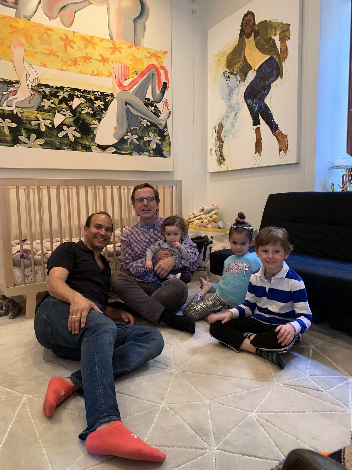 Bernard Lumpkin, Carmine Boccuzzi, and their children with Christina Quarles, Faced, 2016 and Jennifer Packer, Joyce, 2012. Courtesy of Bernard Lumpkin.