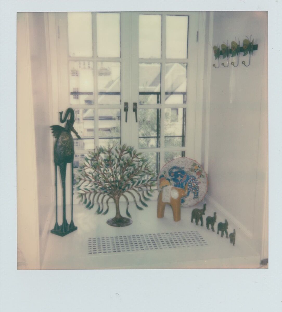 Elephant figurines and other, mostly African, artworks from Clay's personal collection decorate her office.