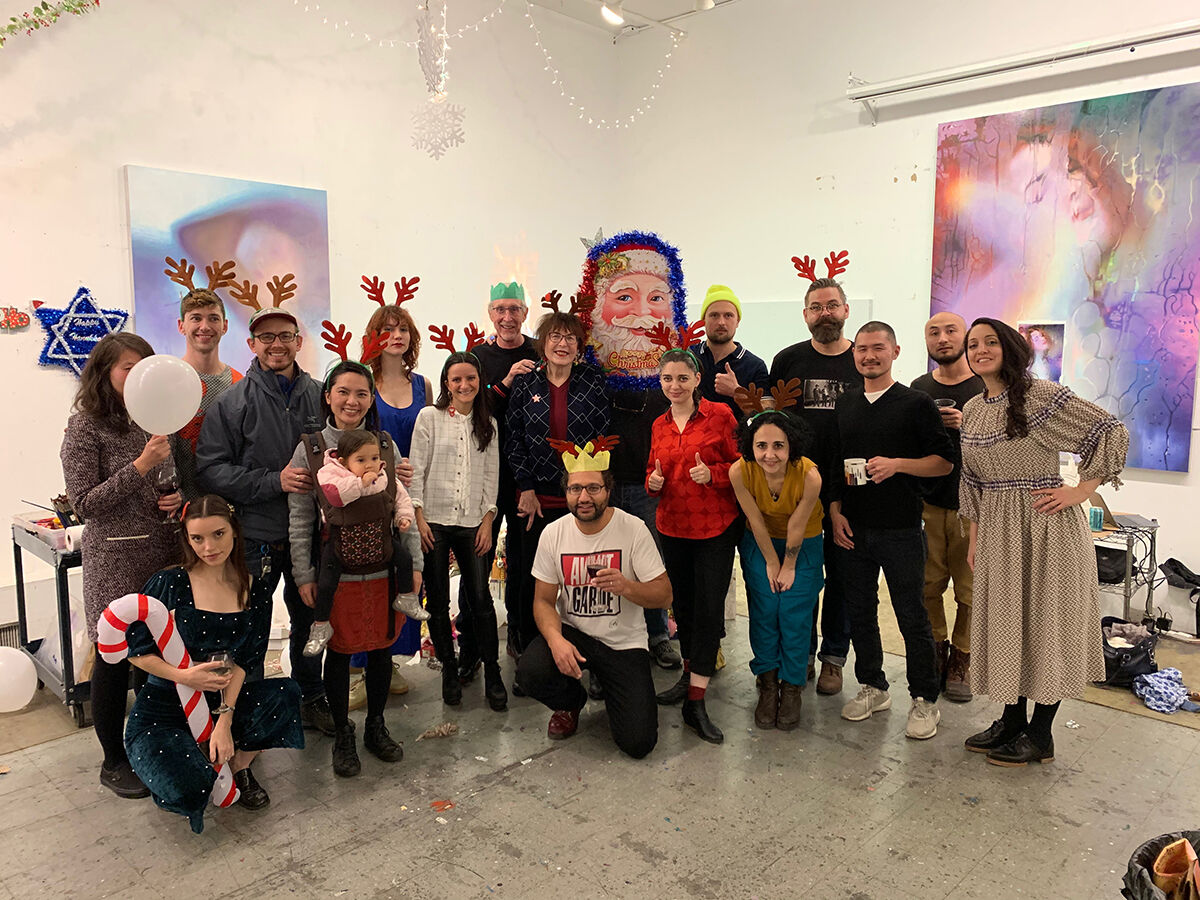 Christmas photo of Marilyn Minter's studio and their families. Courtesy of the artist.