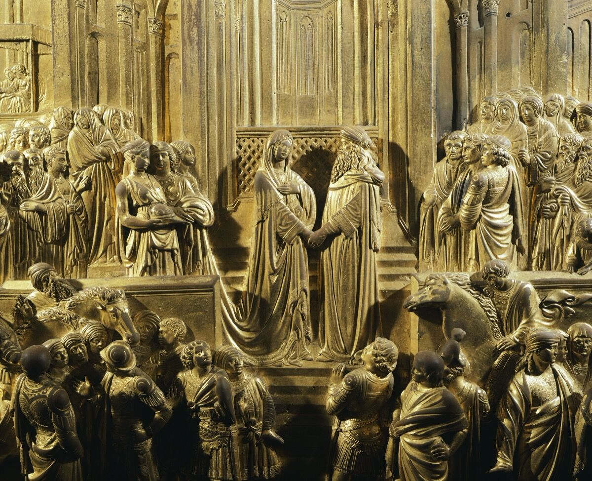 Solomon and the Queen of Sheba, detail from Stories of the Old Testament by Lorenzo Ghiberti, Gates of Paradise, Baptistery of San Giovanni in Florence. Photo by DeAgostini. Image via Getty Images.