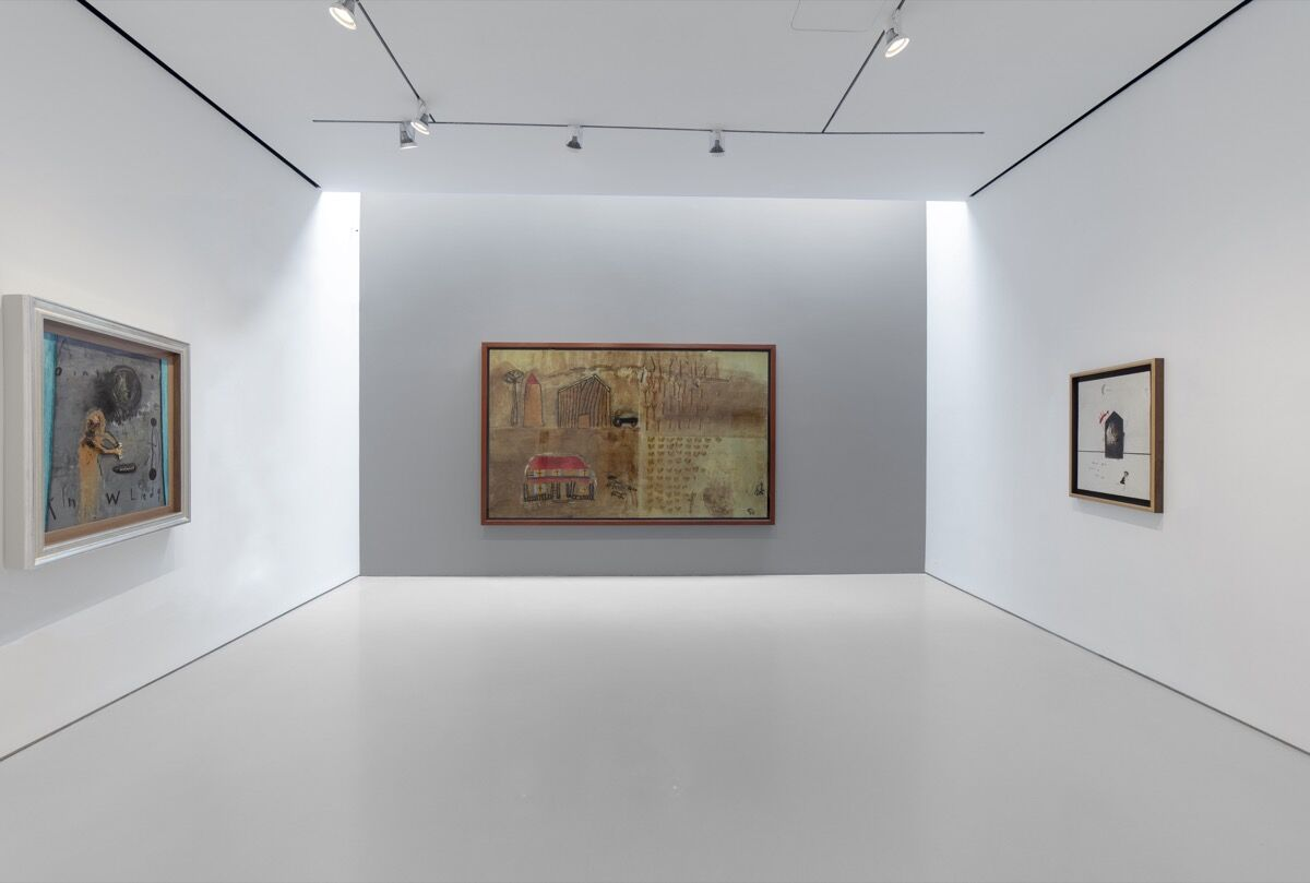 """Installation view of David Lynch, Ointment , 2019; Childhood Painting #1 , 2019; Susie Left home at age 14, 2019, in """"Squeaky Flies in the Mud,"""" at Sperone Westwater, 2019. Courtesy of Sperone Westwater, New York."""