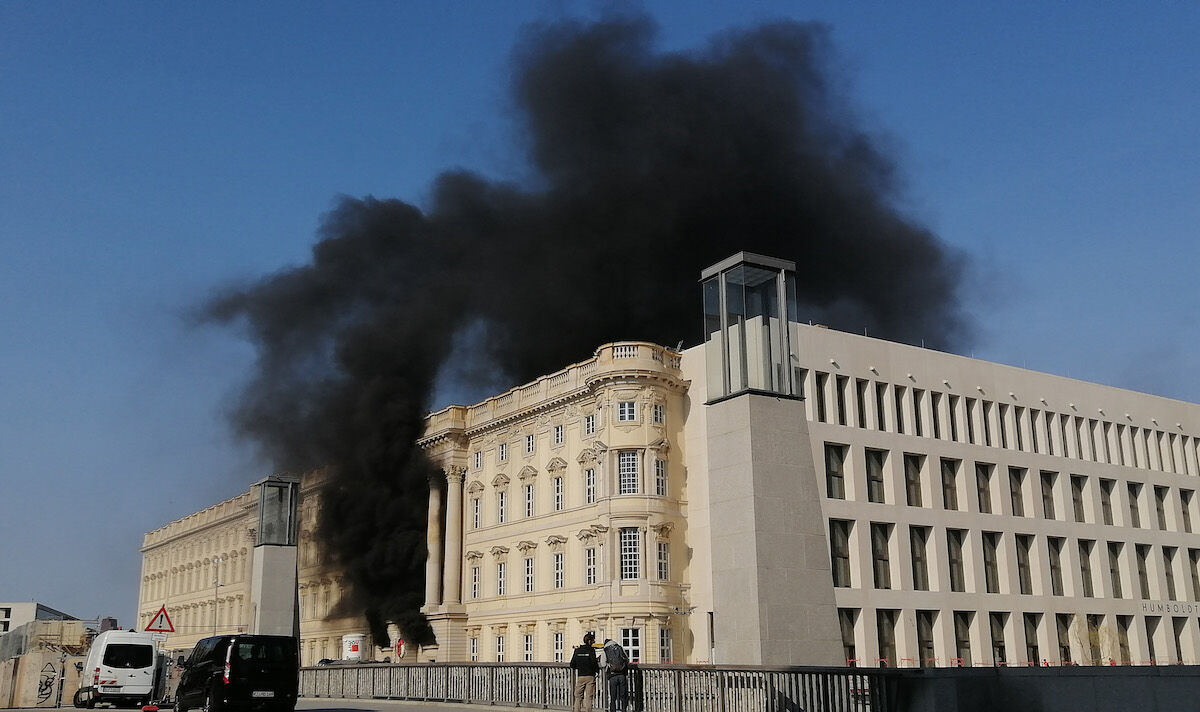 Smoke billows from the future home of the Humboldt Forum museum complex on April 8, 2020. Photo by Konrad Miller/Getty Images.