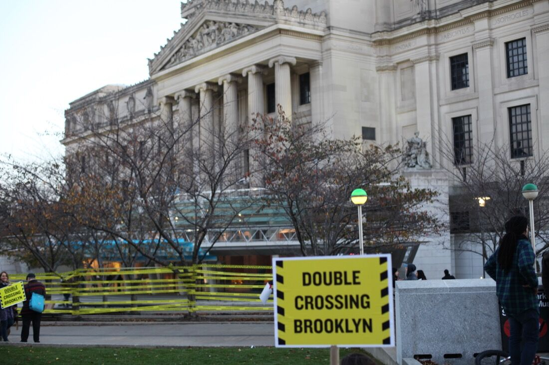 """The """"Double Crossing Brooklyn"""" protest at the Brooklyn Museum.Photo by Isaac Kaplan."""