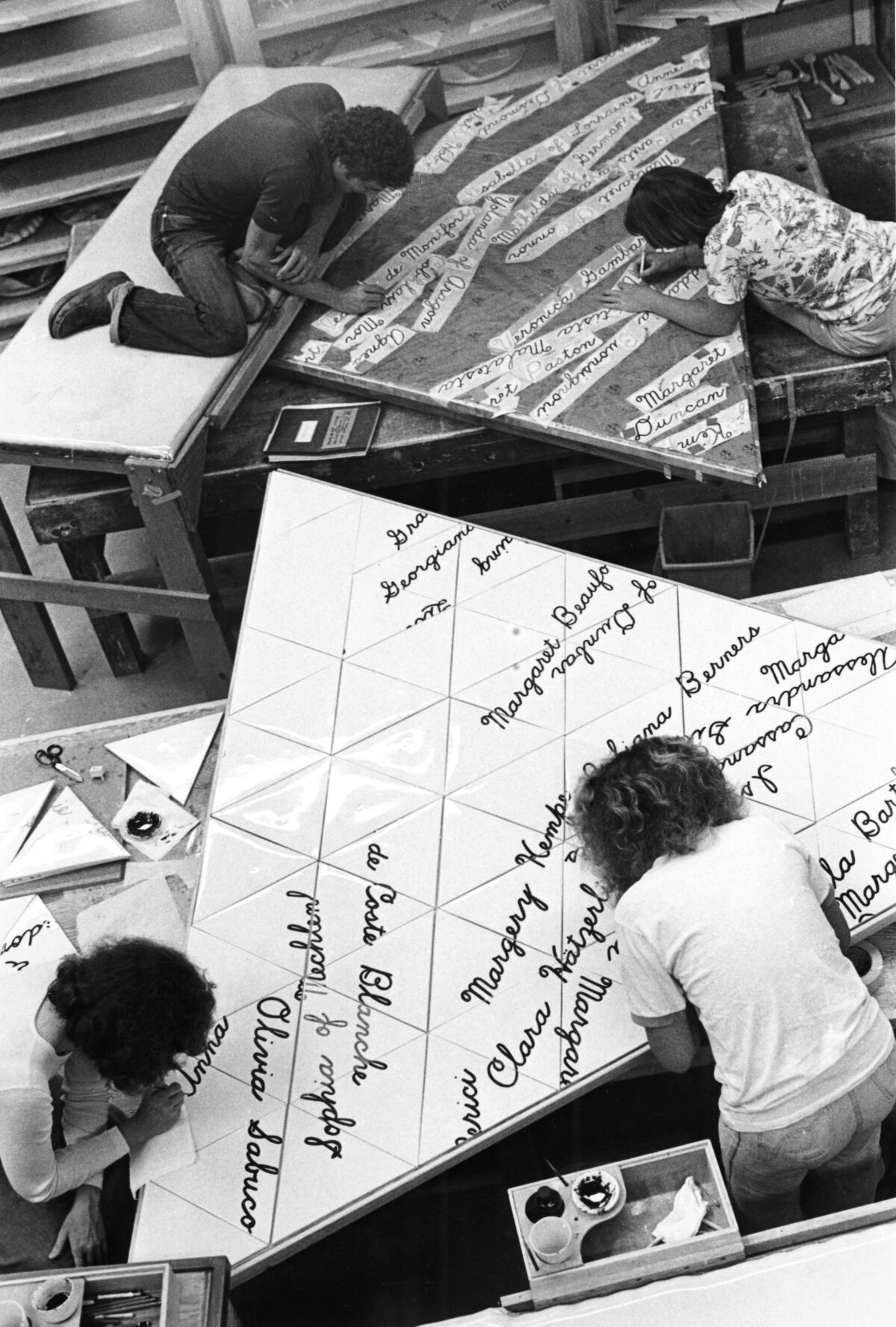 """""""The Dinner Party"""" Workers Painting Names on the Heritage Floor Tiles, 1978. Courtesy of Through the Flower Archive."""