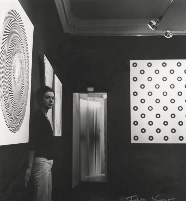 Bridget Riley in her second solo exhibition, 1963. Photo by Ida Kar. © National Portrait Gallery, London.