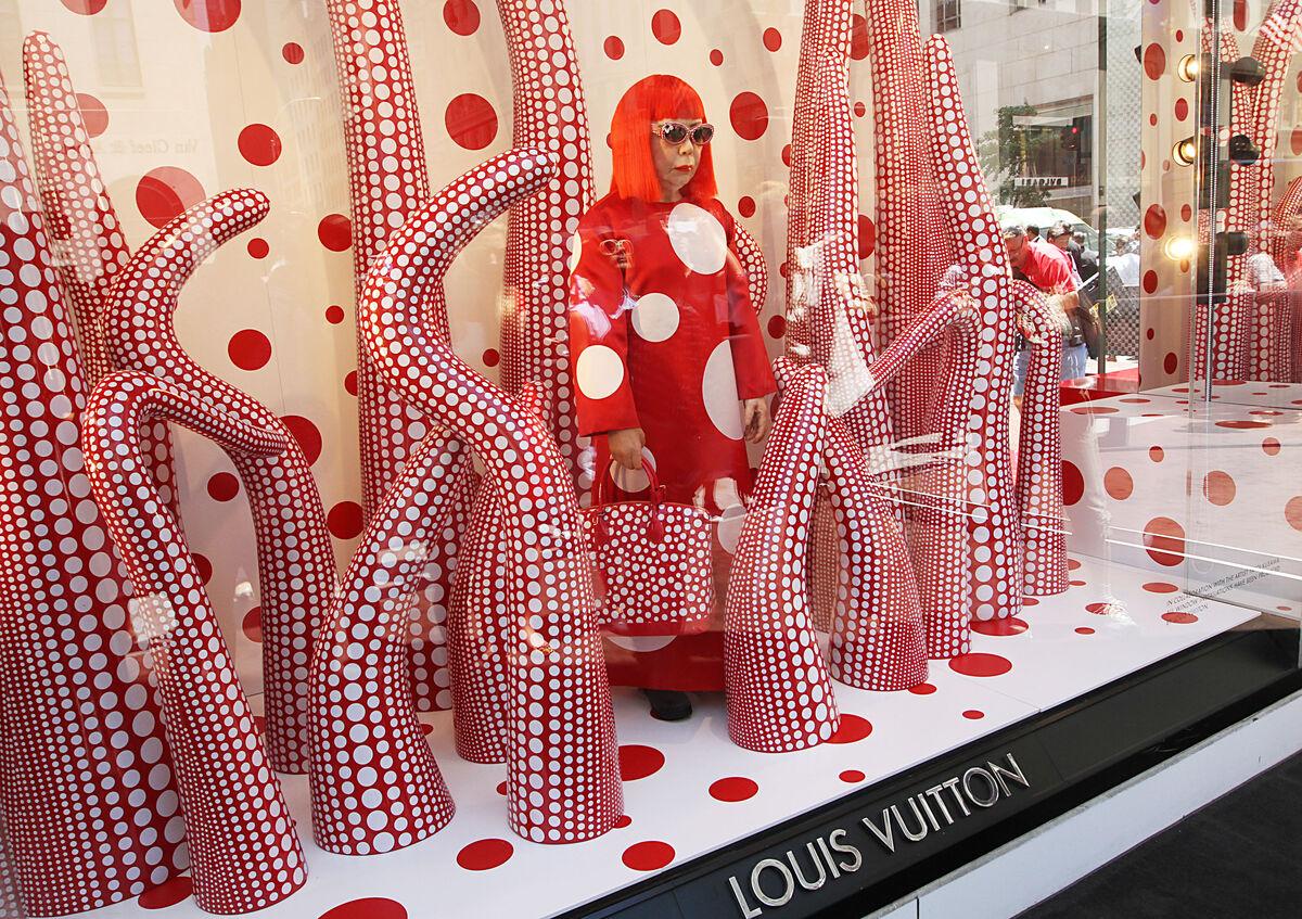 Wax figure of Japanese artist, Yayoi Kusama at the Louis Vuitton and Yayoi Kusama Collaboration Unveiling at Louis Vuitton Maison on Fifth Avenue, New York, 2012. Photo by Rob Kim/FilmMagic.