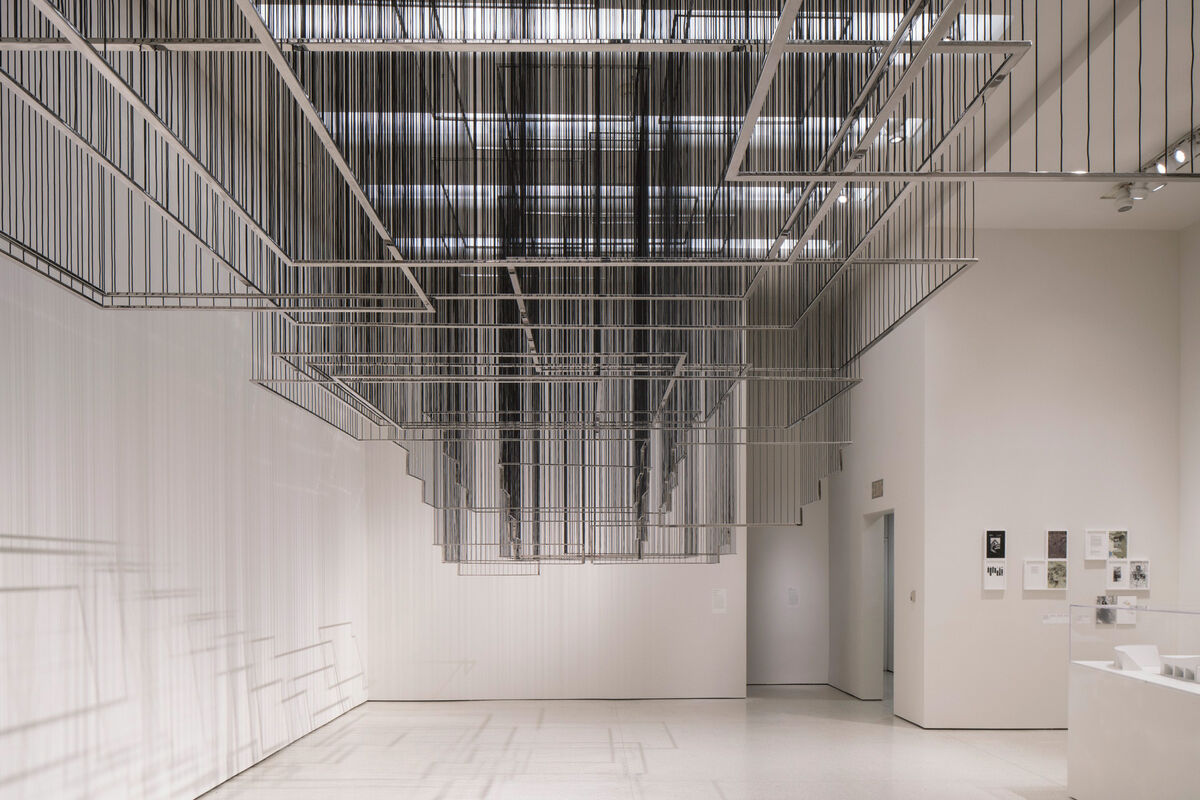 """Installation view of Nadia Kaabi-Linke, Flying Carpets, 2011, and Ala Younis, Plan for Greater Baghdad, 2015, at """"But a Storm Is Blowing from Paradise: Contemporary Art of the Middle East and North Africa,"""" Solomon R. Guggenheim Museum, New York, 2016. Photo by David Heald, courtesy of the Guggenheim Museum."""
