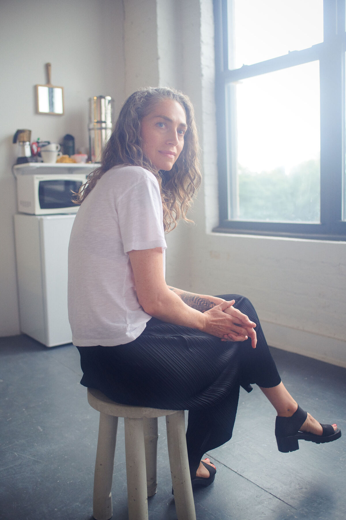 Genesis Belanger in her New York studio by Alex John Beck for Artsy.
