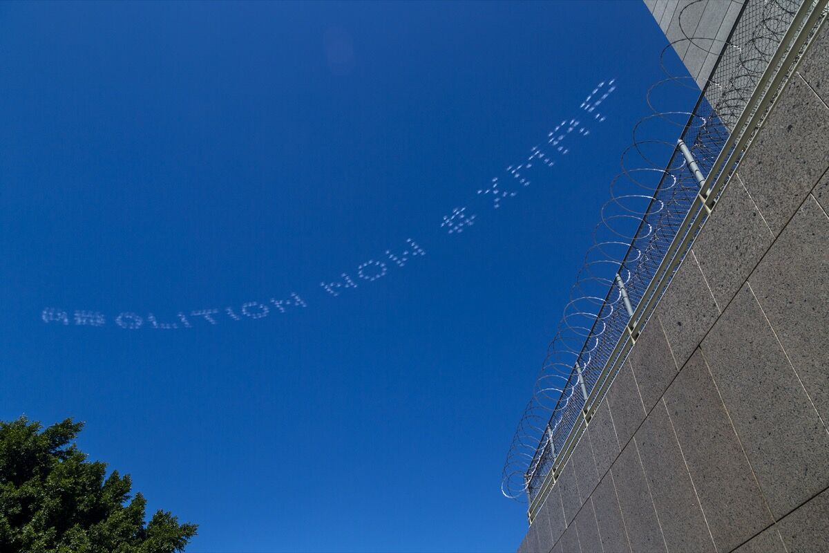 "Ken Gonzales-Day, ABOLITION NOW #XMAP, over LA Immigration Court on July 3, 2020, as part of ""In Plain Sight."" Photo by Davis McNew. Courtesy of In Plain Sight."