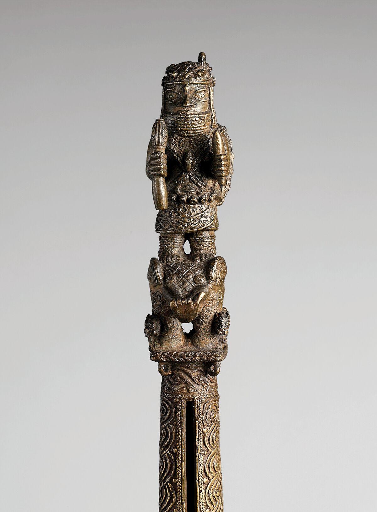 Rattle Staff: Oba Akenzua I Standing on an Elephant (Ukhurhe) (detail), Edo, Nigeria, 1725–50. Courtesy of the Metropolitan Museum of Art.