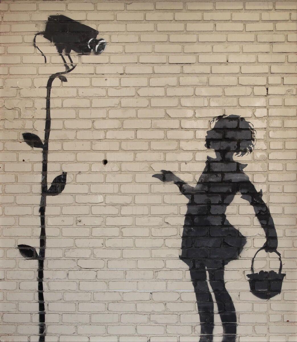 Banksy, Flower Girl, 2008. Courtesy of Julien's Auctions.