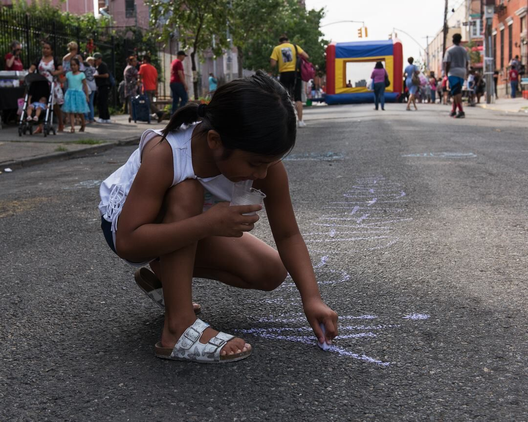 The Bronx Documentary Center's annual block party on 151st Street in the South Bronx, 2018. Photo © Lisa Kahane. Courtesy of the Bronx Documentary Center.