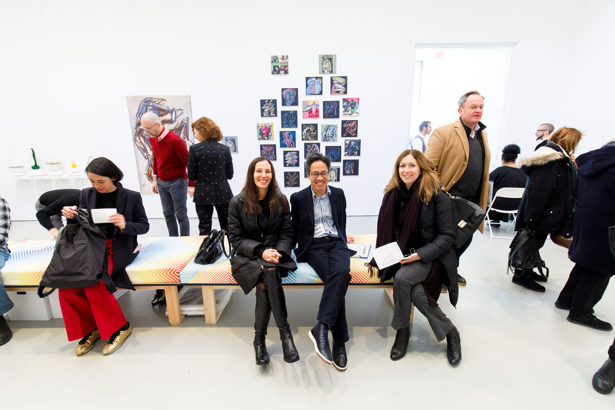 """Director of 1969 Gallery, New York, Quang Bao (center right), relaxes with friends at """"Plan B,"""" 2019. Photo by David Willems Photography. Courtesy of Plan B."""