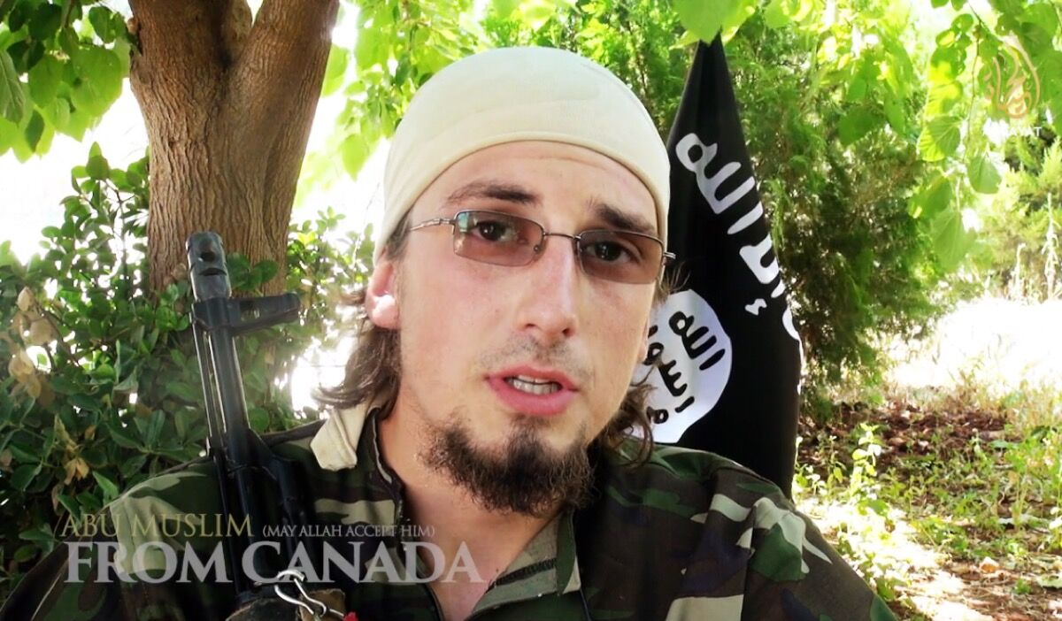 """Abu Muslim from Canada (May Allah Accept Him), 2014 from the series """"Al-Ghuraba: The Chosen Few of Different Lands Video."""" Courtesy ofICP Museum."""