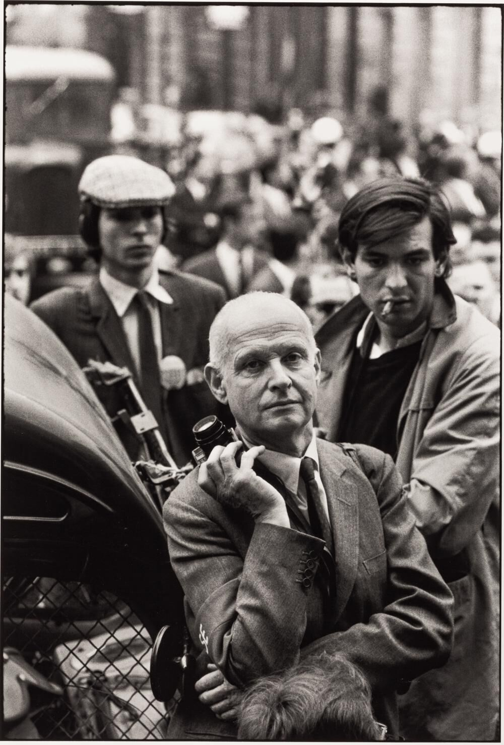 Photographer Henri Cartier-Bresson stands by with his camera during the 1968 Paris riots. Photo by Alain Nogues/Sygma/Sygma via Getty Images.