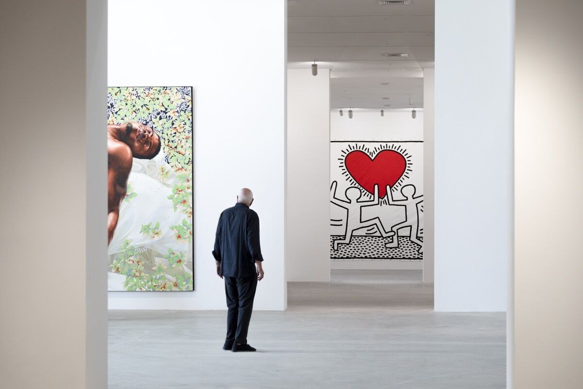 Don Rubell with Kehinde Wiley Sleep, 2008, and Keith Haring, Untitled, 1981, at the Rubell Museum. Photo by Nicholas Venezia, Courtesy of Selldorf Architects.