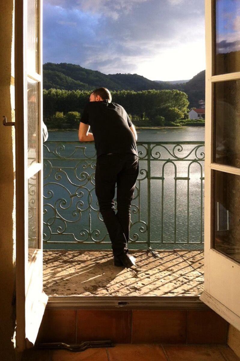 Artist Jean-Baptiste Bernardet at the balcony of his studio at Moly-Sabata, July 2014. Courtesy of Moly-Sabata.